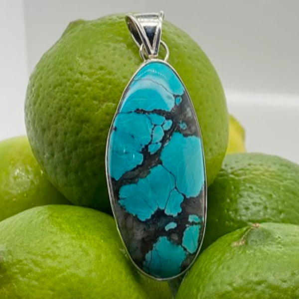 Handmade in Taxco Mexico Artisan Sterling Silver Oval Chinese Turquoise Pendant Brummitt Jewelry Design Studio LLC Raleigh, NC