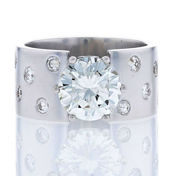 wide platinum engagement ring with scattered etoile flush set diamonds