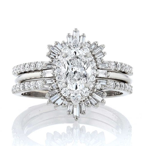 Platinum pear diamond oval halo engagement ring