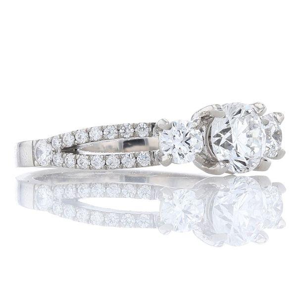 Split shank three stone engagement ring