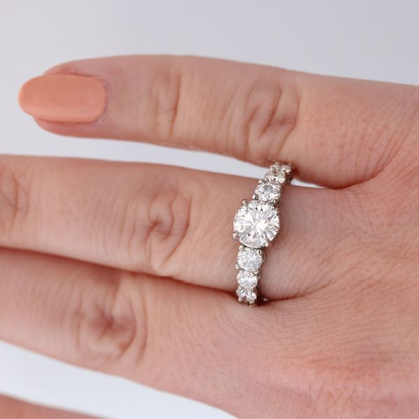 Diamond-engagement-ring-with-diamonds-touching-barely-any-prongs