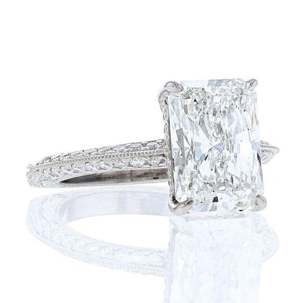 Platinum radiant diamond engagement ring with hidden halo