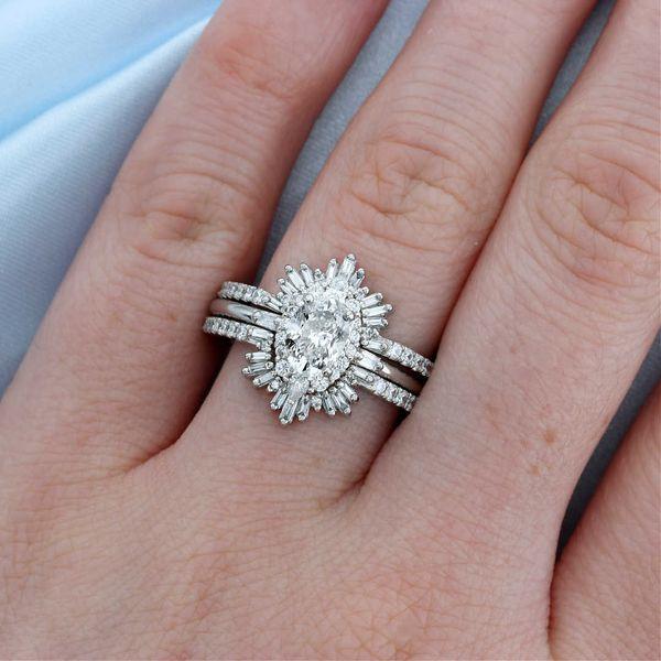 Platinum pear diamond oval halo engagement ring