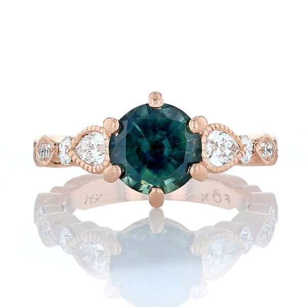 Parti colored teal sapphire engagement ring