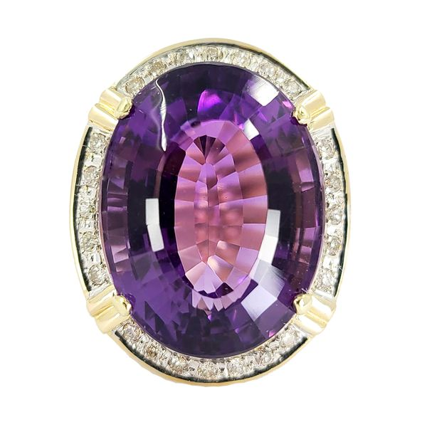 Oval-cut-amethyst-and-diamond-cocktail-ring
