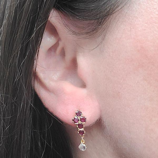 antique ruby dangle earrings on ear