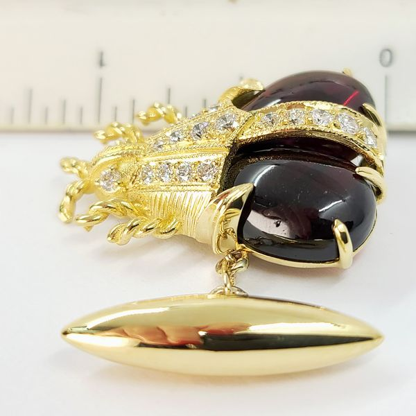 18-karat-gold-beetle-cufflinks-with-garnets