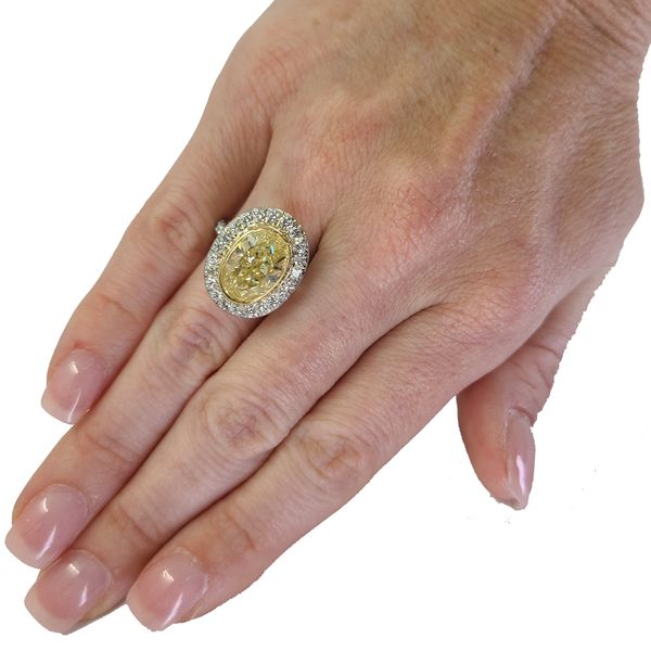 Fancy-yellow-oval-diamond-engagement-ring