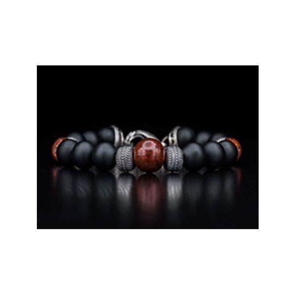 Bead bracelet w/black onyx, sterling silver, & dinosaur bone the only remaining legacy of a Mystique Jewelers Alexandria, VA