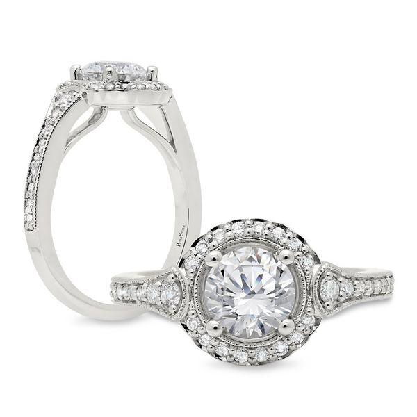 An antique inspired halo diamond ring  Mystique Jewelers Alexandria, VA