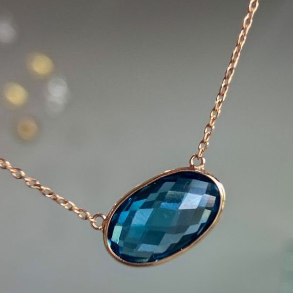 14 kt Yellow Gold Oval East-West Set London Blue Topaz Necklace  Image 2 Parris Jewelers Hattiesburg, MS