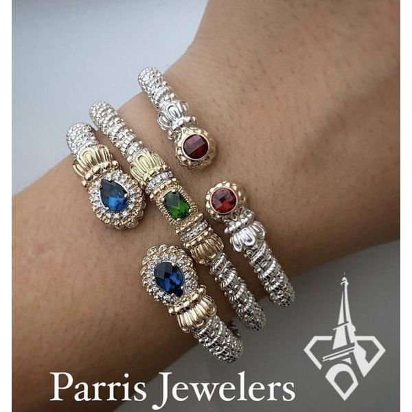 Sterling and Garnet bracelet with 14K gold accent on wrist