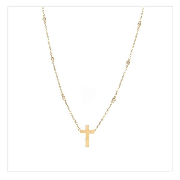 14 kt yellow cross pendant with diamond bezel accent chain