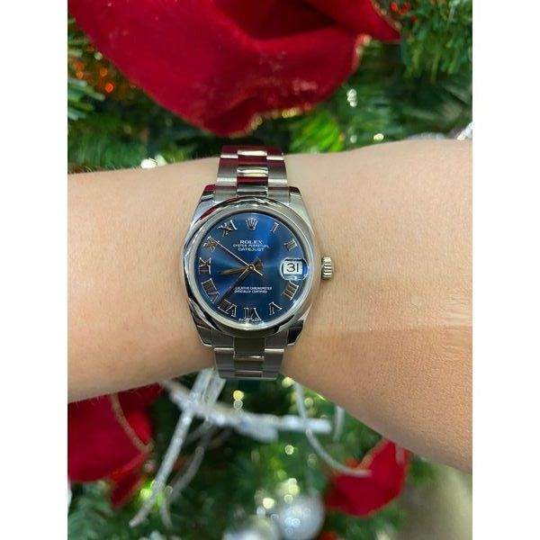 Ladies Rolex Datejust Blue dial and Roman numeral hour markers. 26 mm
