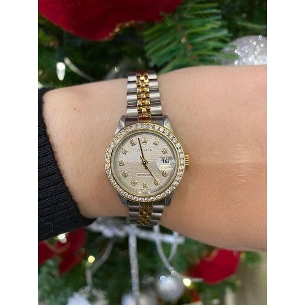 Ladies Rolex Datejust Champagne anniversary style dial and diamond hour markers. 26 mm