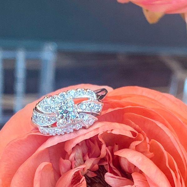 Vintage estate engagement ring on Ranunculus